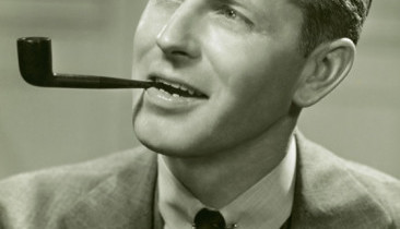 Man_in_Suit_Smoking_Pipe